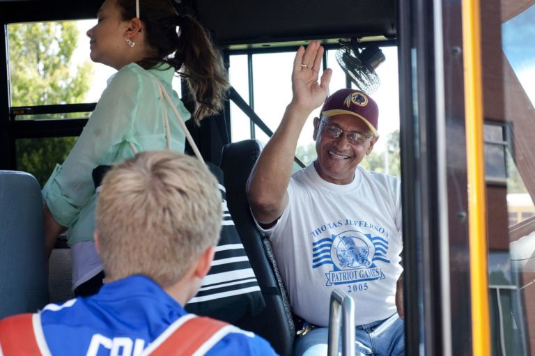 James Bryant welcomes students onto his school bus